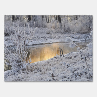Snowy white winter landscape with light reflect yard sign