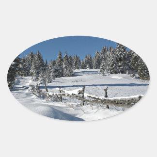 Snowy Winter Scene Oval Sticker