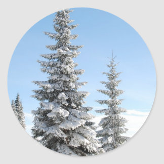 Snowy Winter Scene with Christmas Trees Classic Round Sticker