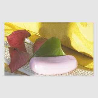 Soap and yellow towel rectangular sticker