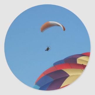 Soaring over the balloons! classic round sticker