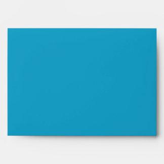 Sobre adaptable azul y poner crema de la invitació