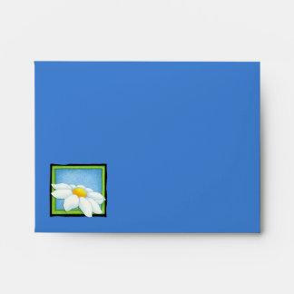 Sobre amarillo azul de la tarjeta de nota de la ma