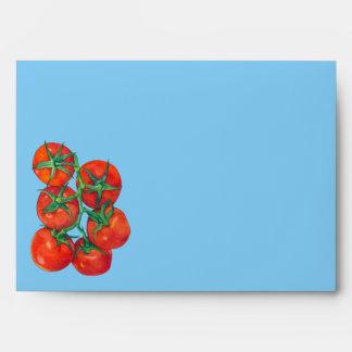 Sobre azul de la tarjeta de los tomates rojos