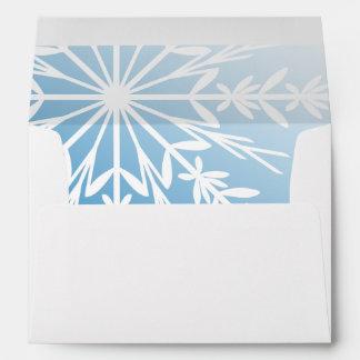 Sobre azul del copo de nieve