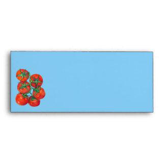Sobre azul del papel con membrete de los tomates r