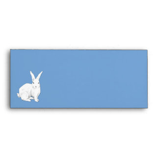 Sobre azul del papel con membrete del conejo