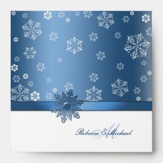 Sobre azul y blanco del invierno del copo de nieve