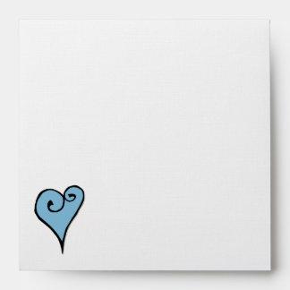 Sobre cuadrado azul del adorno del corazón