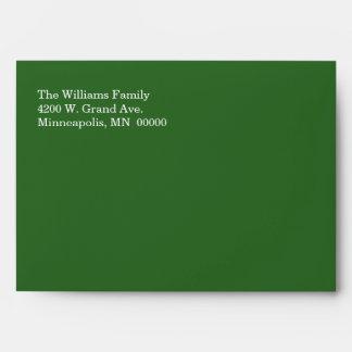 Sobre elegante del día de fiesta del verde y del o