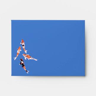 Sobre flotante de la tarjeta de nota azul de Koi