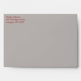 Sobre gris rojo y de color topo A7 del remite