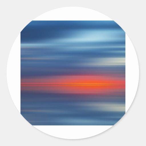 Sobre la puesta del sol del borde pegatina redonda