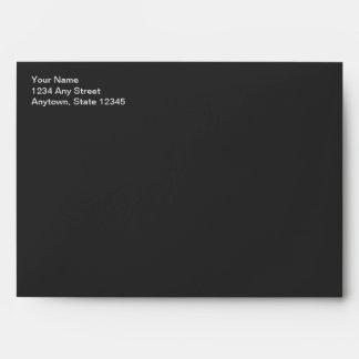 Sobre negro dirigido de la tarjeta de Navidad de l