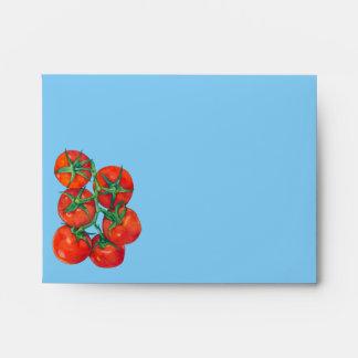 Sobre rojo de la tarjeta de nota azul de los tomat