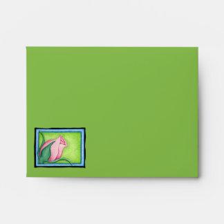 Sobre rosado verde color de rosa de la tarjeta de