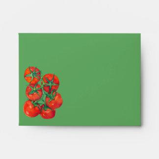 Sobre verde de la tarjeta de nota de los tomates r