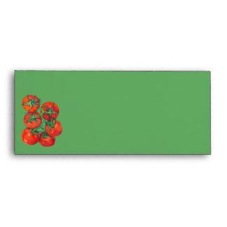 Sobre verde del papel con membrete de los tomates