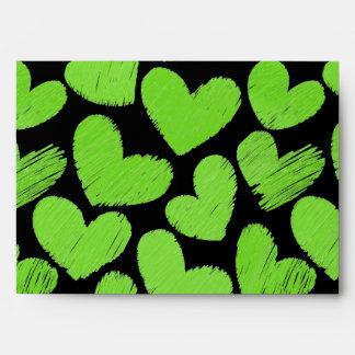 Sobre verde y negro de los corazones