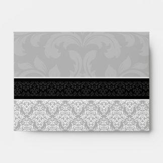 Sobres alineados damasco negro A6 y blanco gris