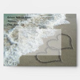 Sobres del boda del destino de la playa