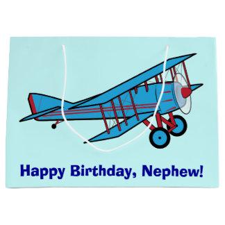 Sobrino del feliz cumpleaños con el aeroplano bolsa de regalo grande