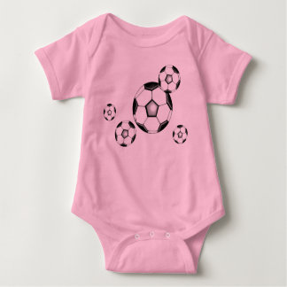 soccer baby: balls and pink baby bodysuit