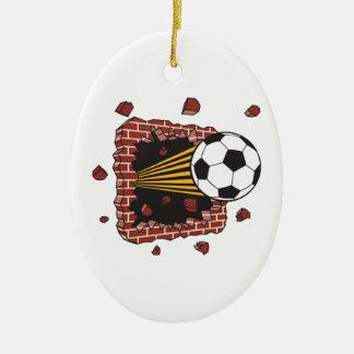 soccer ball breaking through bricks Double-Sided oval ceramic christmas ornament