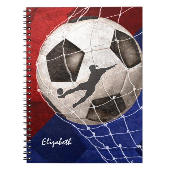 Soccer ball denting the net red blue girl's soccer notebook