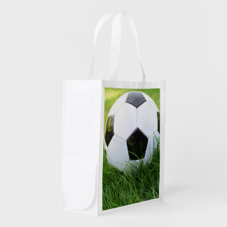 Soccer Ball in the Summer Grass Reusable Grocery Bag