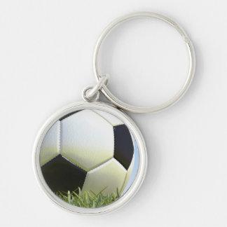 Soccer ball on grass. key chain