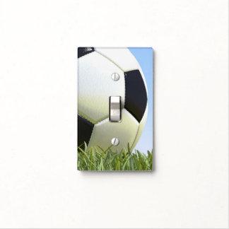 Soccer ball on grass. light switch cover