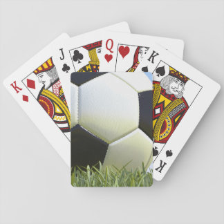 Soccer ball on grass. playing cards