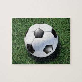 Soccer ball on green grass, close-up puzzles