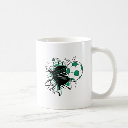 soccer ball ripping thru classic white coffee mug