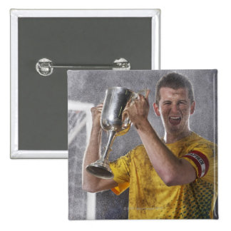 Soccer captain holding up trophy cup on field 2 inch square button