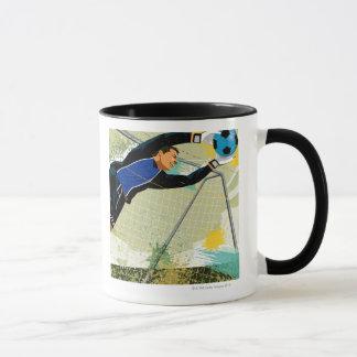 Soccer goalie blocking ball mug
