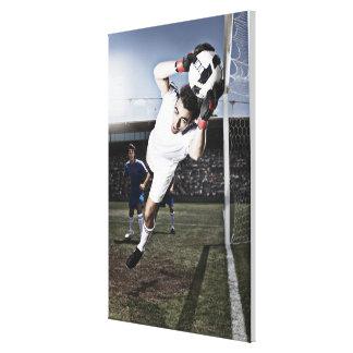 Soccer goalie catching soccer ball canvas print