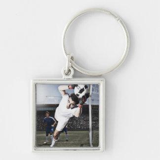 Soccer goalie catching soccer ball keychain