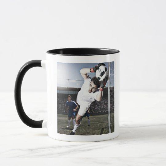 Soccer goalie catching soccer ball mug