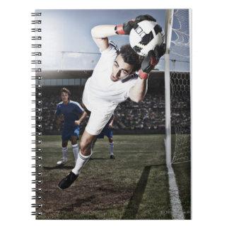 Soccer goalie catching soccer ball notebook