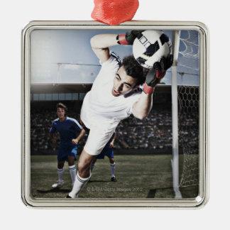 Soccer goalie catching soccer ball ornaments