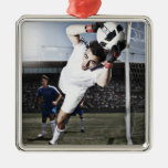 Soccer goalie catching soccer ball ornaments