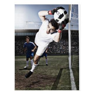 Soccer goalie catching soccer ball postcard