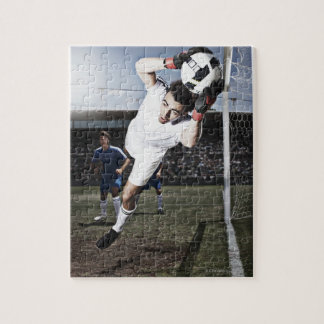 Soccer goalie catching soccer ball puzzles