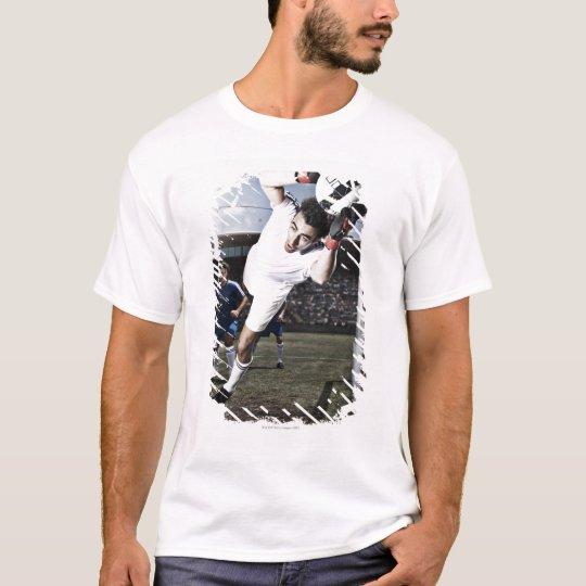 Soccer goalie catching soccer ball T-Shirt
