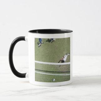 Soccer goalie missing soccer ball mug