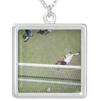 Soccer goalie missing soccer ball pendant
