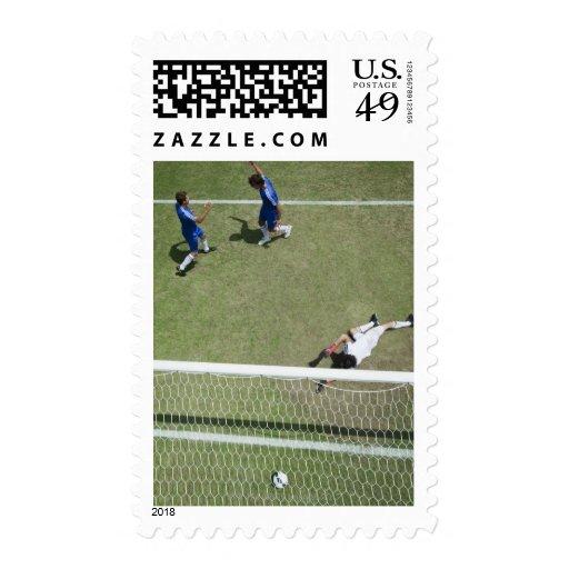 Soccer goalie missing soccer ball postage stamp