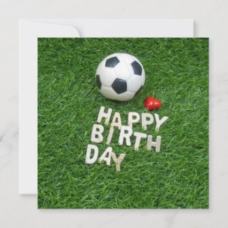 Soccer happy birthday with football on green grass